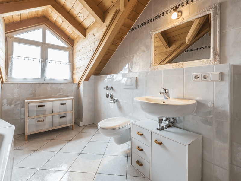Attic bathroom with wood accents